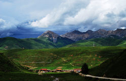 A small village below mountain in Tibet Stock Photos