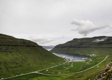 Small village in calm bay in the Faroe Islands, Denmark, Europe Royalty Free Stock Photos