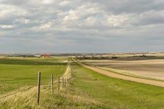 Small village of Canadian Prairies. Scenic view of Canadian Prairies and small village of Mankota  in background  Saskatchewan Stock Image