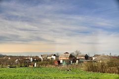 Small village. The Caucasian Mineralnye Vody in Stavropol Krai, a picturesque landscape near Elbrus, bright green fields against Pyatigorya, Mount Beshtau, a Stock Photo