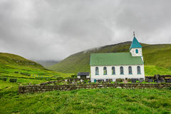 Small village church with cemetery in Gjogv, Faroe Islands, Denm Stock Images