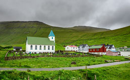 Small village church with cemetery in Gjogv, Faroe Islands, Denmark Stock Images