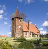 Small village church on hill. A small church on a hill, spring colours. Sucha Koszalinska, Poland, near Koszalin. Wide angle, decorative lawn in the foreground Royalty Free Stock Photo
