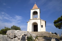 Small village church on the hill Stock Photography