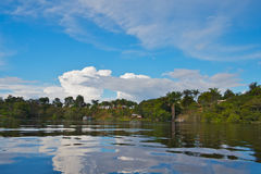 Small village on the coast of Amazon river Stock Photos