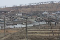Rural scene in North Korea DPRK. Small village / commune in DPRK traditional houses Stock Photography