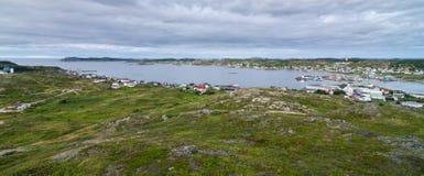 Small village community in Newfoundland.  Houses nestled amongst rocky landscape in Twillingate Newfoundland, Canada. Royalty Free Stock Images
