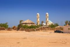 Small village on the desert with mosque. Egypt Stock Photo