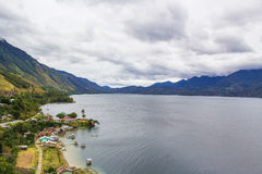 Small Village On the Edge of The Lake Lut Tawar Takengon Aceh. A small village with a friendly people who live on the Edge of The Lake Lut Tawar Takengon Aceh Royalty Free Stock Images