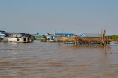 A small village of fishermen with a pile houses tonlesap Stock Image