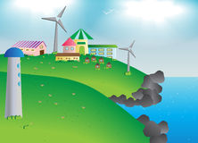 Small village with flower and wind mill on hill and ocean Royalty Free Stock Images
