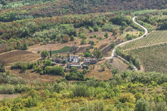 Small village in the forest. A small village in the forest with fields and vineyards around. Croatia Royalty Free Stock Images
