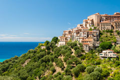 Small village in front of the sea. Pisciotta is a small village in the National Park of Cilento (south Italy) built on a hill right in front of the Mediterranean Royalty Free Stock Image