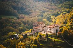 Small village among the green Italian hills. Royalty Free Stock Image