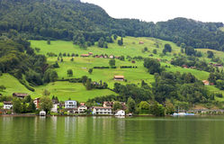 The small village on the hills around Lake Luzern Stock Image