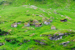 Small village houses at green valley Stock Images