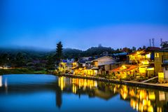 Pilok village is beside the lake in the valley, Twilight the beautiful light reflected in water. The small village is beside the lake in the valley, Twilight the stock photography