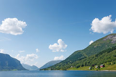 Small village located on the fjord shore Stock Photos