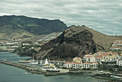 Small Village on Madeira Island, Portugal. Vintage view on a small village on the South coast of  Madeira Island, Portugal Stock Image
