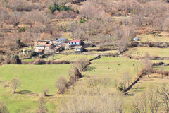 Small Village and Meadows. Small village of Spain in rustic scene with meadows and some sheeps stock photos