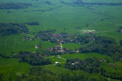 A Small Village in the middle of Rice Fields. A Small Village in West Java is surrounded by vast rice fields royalty free stock photos
