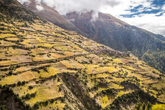 Small village in the mountains, surrounded by farm fields. View from the trekking at Annapurnas circuit, Himalaya, Nepal Royalty Free Stock Photos