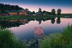 Small village near beautiful lake with drowned bri Royalty Free Stock Image