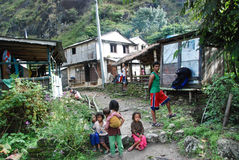Small village in nepal. Small dirty path with some houses and local people in village in nepal Royalty Free Stock Photos