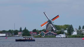 Small village in the Netherlands with the typical Windmills - Amsterdam - The Netherlands - July 19, 2017 stock footage