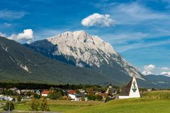 Obermieming Village and Eastern Alps in Tyrol Austria. The small village of Obermieming in Tyrol state, Austria. In the background the Mieming Range or Mieminger royalty free stock photography