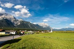 Obermieming Village and Eastern Alps in Tyrol Austria. The small village of Obermieming in Tyrol state, Austria. In the background the Mieming Range or Mieminger royalty free stock photos