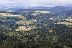 Stolowe Mountains in Poland. Small village Pasterka, view from Szczeliniec Wielki in Table Mountains National Park in Sudetes, Poland Royalty Free Stock Images