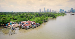 Small village on the river bank in Saigon, Vietnam Stock Photography