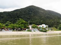 Small village by the sea with beach and mountain. View of small village by the sea, in summer day with beach and mountain Royalty Free Stock Photo
