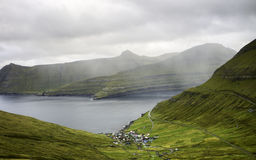Small village by the sea on a rainy day: Funningur, Faroe islands, Denmark, Europe Stock Photo