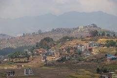 Small village settled on a hill in Nepal royalty free stock photo