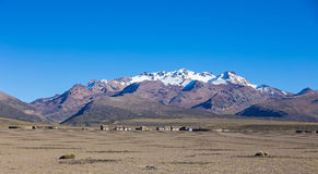 Small village of shepherds of llamas in the Andean mountains. An Stock Image