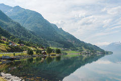 Small village at the shore of fjord, Norway. Hardangerfjord Royalty Free Stock Images