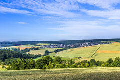 Small village in the Taununs with fields. Under blue sky stock images