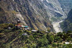 A small village at top of hill amid the mountain region at Himachal Pradesh Stock Photo