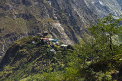A small village at top of hill amid the mountain region at Himachal Pradesh Stock Image