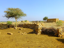Small village with traditional houses in Thar desert near Jaisal Stock Image