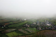 The small village under the cloud and mist Stock Photo