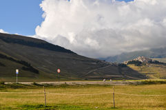 Small village under clouds in the Apennines landscapes Stock Photography
