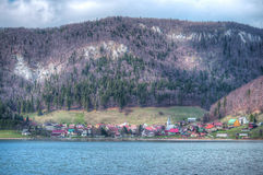 Small village under the mountains - HDR Stock Photos