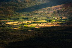 A small village in a valley surrounded by forest and mountains Royalty Free Stock Image