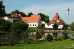 Small village Varvazov, Czech republic. Picturesque small village Varvazov with pond, church and part of castle in summer, Czech republic, South Bohemia Royalty Free Stock Photos