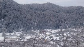 Small village in winter stock video footage