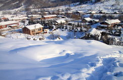 Small village in winter. A typical small peaceful village in northeast of China. Ground was covered by heavy snow Royalty Free Stock Photos