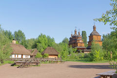 Small village and wooden church Stock Photography